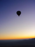 Silhouette of hot air balloons flying over the Cappadocia valley Royalty Free Stock Photo
