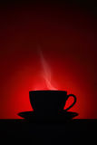 Silhouette of hot coffee cup on red background Royalty Free Stock Images
