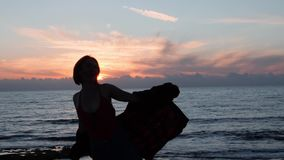 Silhouette of hot girl dancing and laughing at sunset. Young attractive girl posing at camera. Silhouette of woman dancing and smi stock footage