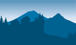 Silhouette of houese in hills Stock Photos