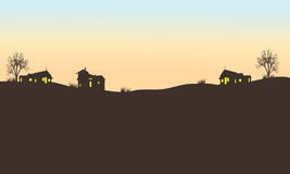 Silhouette of house in field. At the afternoon Stock Photos