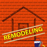 The silhouette of the house on a red brick wall. House remodel company logo. Royalty Free Stock Photography