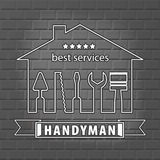 Silhouette of a house with tools for repair. Handyman logo on brick wall background in grey. Stock Image