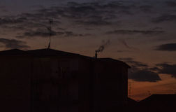 Silhouette of house under sunset light Royalty Free Stock Images