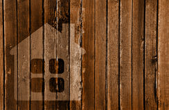 Silhouette of a house in a wooden wall Royalty Free Stock Photography