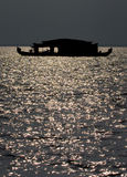 Silhouette of Houseboat. Silhouette of a traditional houseboat in Kerala backwaters Stock Photo