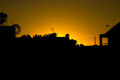 Silhouette of houses with a church. sunset Royalty Free Stock Photography