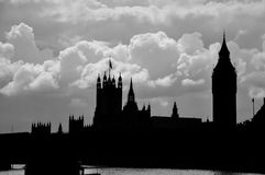 Silhouette of Houses of Parliamant and Big Ben. Black and white silhouette of Houses of Parliament and Big Ben, with river Thames in front and dramatic cloudy Royalty Free Stock Images