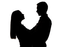 Silhouette of hugging couple Stock Image