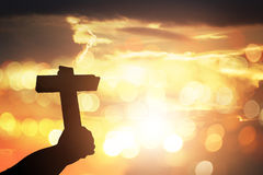 Silhouette human hands holding a cross holy and prayed for bless. Ings from god. Amour worship god concept background Stock Photos