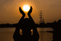 Silhouette of human in meditation and prayer Stock Photography