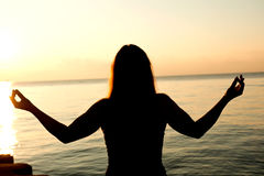 Silhouette human open empty hands with palms up over sun Royalty Free Stock Image