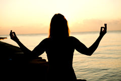 Silhouette human open empty hands with palms up over sun Stock Photography