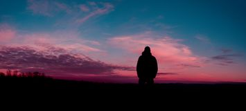 Silhouette of Human With Sunset Background Stock Photos
