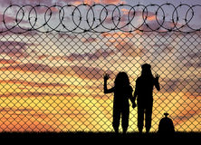 Silhouette of hungry children refugees Royalty Free Stock Photo