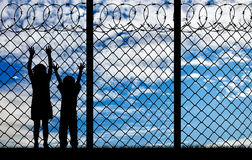 Silhouette hungry refugee children Royalty Free Stock Images