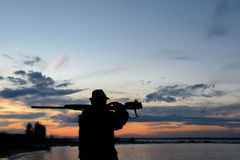 Silhouette of the hunter Stock Image