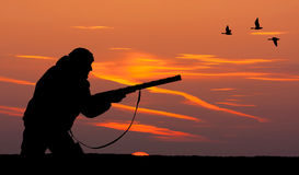 The silhouette of a hunter at sunset Royalty Free Stock Image