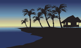 Silhouette of hut and palm Stock Photography