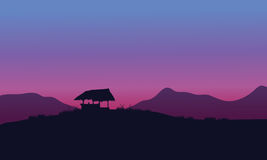 Silhouette of hut with purple backgrounds Stock Photography