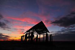 Silhouette hut at sunset. Royalty Free Stock Photos
