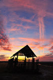 Silhouette hut at sunset. Royalty Free Stock Image
