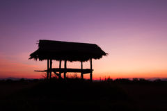 Silhouette of a hut and tree at sunset in Chiang rai, Thailand Royalty Free Stock Image