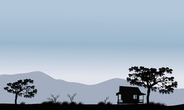Silhouette of hut with trees Stock Photos