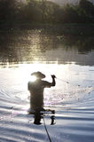 Silhouette if a fisherman Royalty Free Stock Image