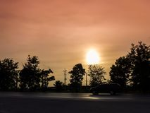 Silhouette image - The car on the road with the trees at sunset.  royalty free stock photo
