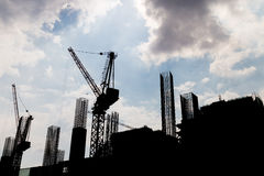 Silhouette image of construction site against blue sky Stock Images