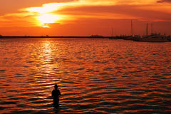 Fisherman-and-sunset Royalty Free Stock Photos