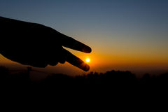 silhouette image of  hand point to the sun Stock Photography