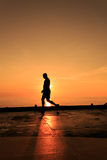 Silhouette Image of man walking on the helideck Royalty Free Stock Photos