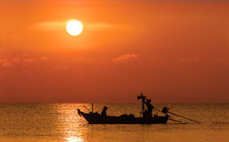 Silhouette Image Of Fishermen In Fishing Boat Royalty Free Stock Photography