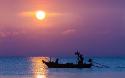 Silhouette Image Of Fishermen In Fishing Boat Stock Photos