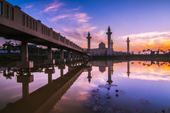 The silhouette image of sunset at mosque. Sunrise over the mosque. reflection of mosque Royalty Free Stock Photography