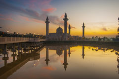 The silhouette image of sunset at mosque. Sunrise over the mosque. reflection of mosque Royalty Free Stock Image