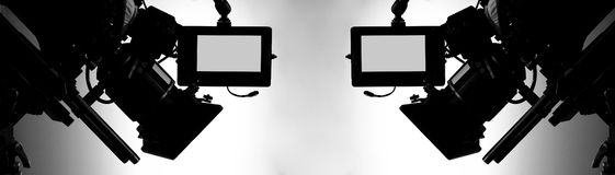 Silhouette images of video camera in tv commercial studio production stock photography