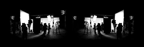 Silhouette images of video production behind the scenes. Or b-roll or making of TV commercial movie that film crew team lightman and cameraman working together stock photography