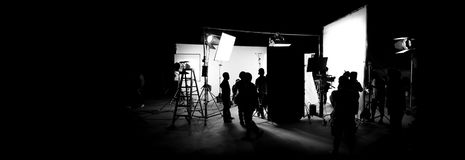 Silhouette images of video production behind the scenes. Or b-roll or making of TV commercial movie that film crew team lightman and cameraman working together royalty free stock image
