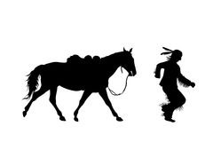 Silhouette of indian running with a horse Stock Photos