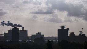 Silhouette of industrial plants in Hamburg harbor Stock Photography