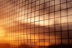Silhouette of the iron fence with sunset background. Royalty Free Stock Photos