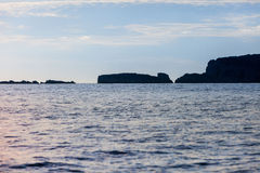 Silhouette of islands line Stock Images