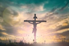 Silhouette of Jesus with Cross over sunset concept for religion, worship, Christmas, Easter, Redeemer Thanksgiving prayer and royalty free stock photography