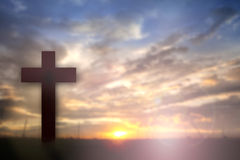 Silhouette of Jesus with Cross over sunset concept for religion, worship, Christmas, Easter, thanksgiving prayer and praise. stock photography