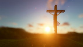 Silhouette of Jesus with Cross over sunset, religious concept, blurry background stock video