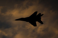 Silhouette of a jet fighter with afterburner. Mikoyan-Gurevich MiG-29AS Fulcrum Royalty Free Stock Image
