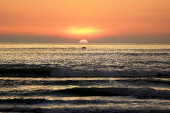 Silhouette of jet ski running pass the Beautiful Sea Sunset Royalty Free Stock Photography
